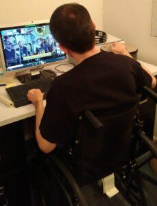 Greg at his computer